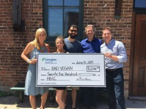 Rose and John Forgues from Bad Vegan (second from left) receive $2,500 from the Henry Bernick Entrepreneurship Centre (HBEC) for placing second in the recent exC!te Business Pitch Competition. HBEC's Programs and Partnership Manager Sara Bentham, Don Bourne, HBEC Client Service Advisor and mentor (second from right), and Tim Newton, manager of the South Georgian Bay Small Business Enterprise Centre (far right), presented the prize.